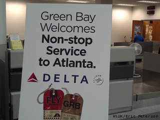 A sign at Austin Straubel International Airport in Ashwaubenon Jan. 28, 2013, advertises daily non-stop flights to and from Atlanta, scheduled to begin in June 2013. (courtesy of FOX 11).