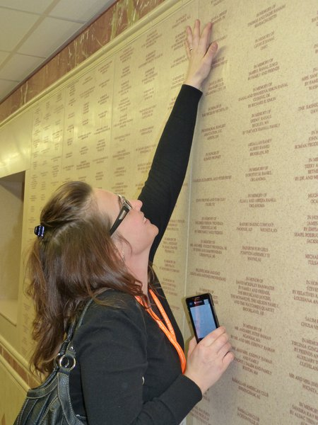 Charli McKenzie checks out Elvis on the Donor Wall