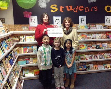 Pictured: West Ottawa School Psychologist Tanya Uganski (back row left) and Woodside Elementary Interim Principal Jacquelyn DelRaso present the Great Lakes Energy Grant with students Javier Carrillo, Jessica Koeman and Juana Martinez. (photo courtesy West Ottawa Public Schools)