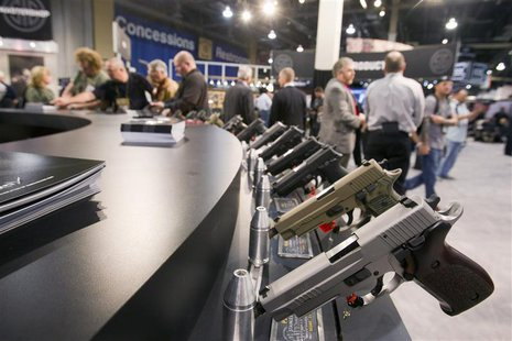 Sig Sauer handguns are displayed during the annual SHOT (Shooting, Hunting, Outdoor Trade) Show in Las Vegas January 15, 2013. REUTERS/Las V