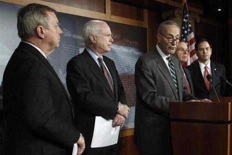 (L-R) Senators Richard Durbin (D-IL), John McCain (R-AZ), Charles Schumer (D-NY), Robert Menendez (D-NJ), and Marco Rubio (R-FL) attend a ne