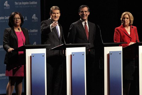 Los Angeles Mayoral candidates L-R Jan Perry, Kevin James, Eric Garcetti, and Wendy Greuel stand on stage during debate of candidates for ma