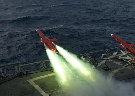 A U.S. Navy BQM-74E drone launches from the flight deck of the guided missile frigate USS Underwood (FFG 36) during a live fire exercise in