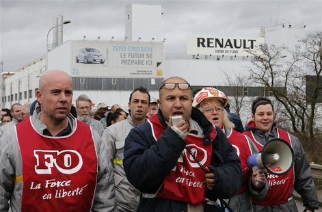 Employees of French car maker Renault demonstrate against the company's new labour deal in front of the Renault car factory in Flins, near P