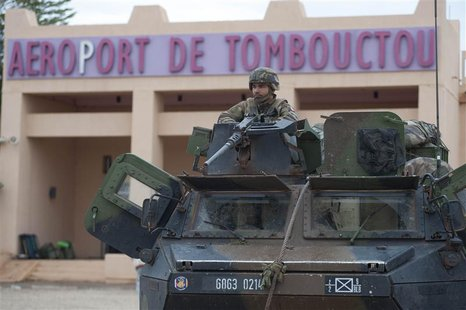 French troops, aboard an armoured vehicle, guard the Timbuktu airport in this January 28, 2013 picture provided by the French Military audio