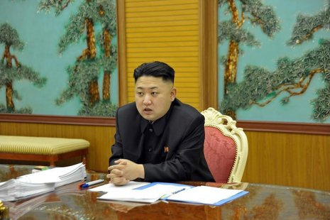 North Korean leader Kim Jong-Un presides over a consultative meeting with officials about state security and foreign affairs in this undated