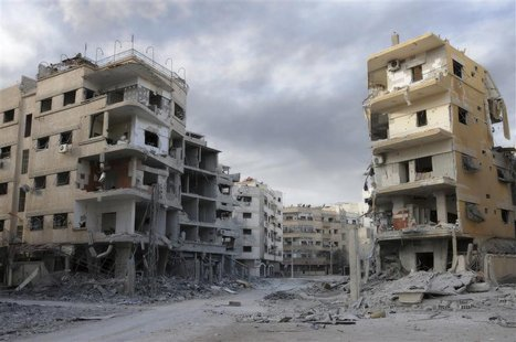 A general view shows damaged buildings in Mleha suburb of Damascus, January 24, 2013. REUTERS/Sami Zbeidi