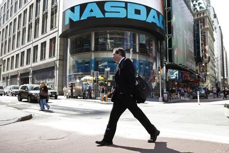 A pedestrian walks past the NASDAQ building in New York City, April 30, 2010. REUTERS/Lucas Jackson