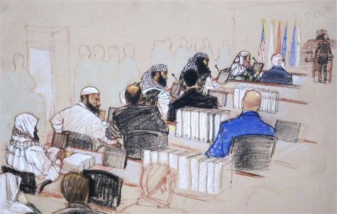 (L-R, wearing camouflage) Ramzi, Walid bin Attash and Khalid Sheikh Mohammad, three of the alleged conspirators in the 9/11 attacks, attend