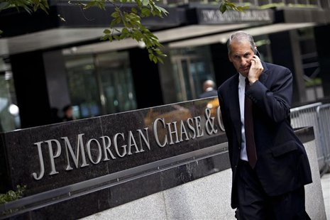 A man walks past JP Morgan Chase's international headquarters on Park Avenue in New York in this July 13, 2012 file photo. REUTERS/Andrew Bu