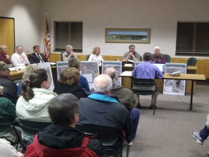 About 40 residents attended the Rothschild Village Board meeting 1/28/13 concerned about the proposed Pavilion Market Place Development Plan
