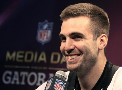 Baltimore Ravens quarterback Joe Flacco answers questions from journalists during Media Day for the NFL's Super Bowl XLVII in New Orleans, L