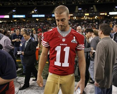 San Francisco 49ers quarterback Alex Smith walks on the field after he was not given a booth to answers question from journalists during Med