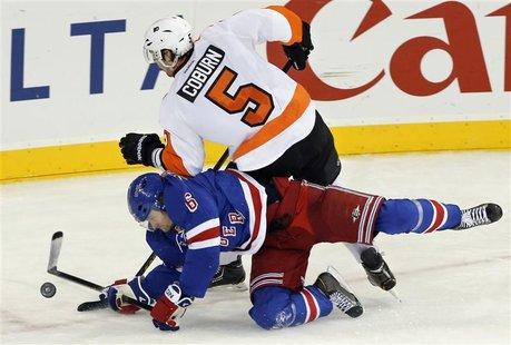 New York Rangers defenseman Anton Stralman (6) dives to stop a shot by Philadelphia Flyers defenseman Braydon Coburn (5) in the third period