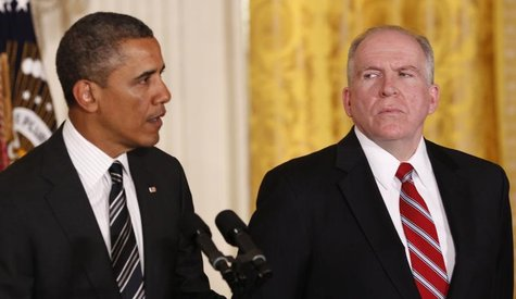 White House counterterrorism advisor John Brennan (R) listens as U.S. President Barack Obama nominates him to become the next CIA director a