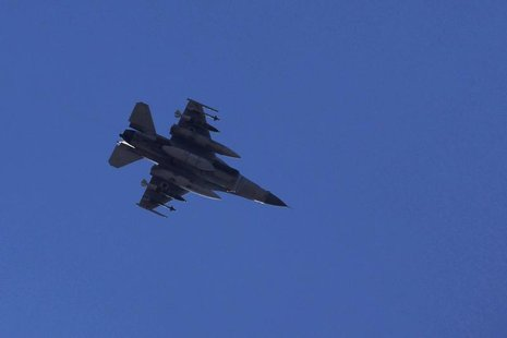 An Israeli F16 fighter jet flies over the southern city of Ashdod in this file photo taken November 15, 2012. REUTERS/Amir Cohen