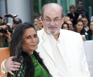 "Director Deepa Mehta (L) and author Salman Rushdie arrive at the gala presentation for the film ""Midnight's Children"" during the 37th Toront"