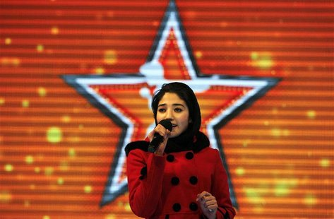 "Afghan's Latifa Azizi performs on the ""Afghan star"" talent show in Kabul January 29, 2013. REUTERS/Omar Sobhani"