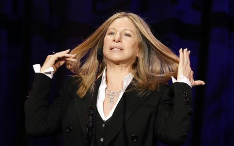 Singer and actress Barbra Streisand reacts as she speaks on stage at the Public Counsel's 40th anniversary event in Beverly Hills, Californi