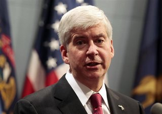 Michigan Governor Rick Snyder holds a news conference to talk about why he signed into law, earlier in the day, right-to-work laws in Lansin