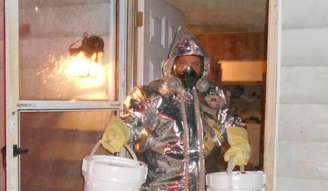 In this photo supplied by the Calhoun County Sheriffs Department, a deputy is shown wearing a protective suit to remove the volatile, flammable and toxic chemicals used to manufacture the illicit drug.
