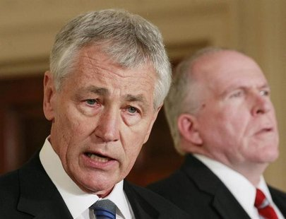 U.S. President Barack Obama's nominee for Secretary of Defense, former Senator Chuck Hagel (L), stands next to counterterrorism adviser John
