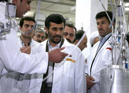 Iranian President Mahmoud Ahmadinejad (C) visits the Natanz nuclear enrichment facility, 350 km (217 miles) south of Tehran, April 8, 2008.