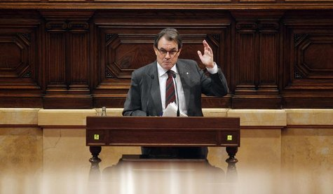 Catalunya's President Artur Mas gestures during a speech at a session of the Catalunya's Parliament in Barcelona, January 23, 2013. REUTERS/