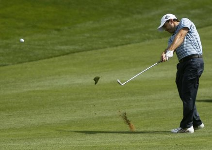 Richard Sterne of South Africa hits a shot from the eighth fairway during the first round of the Dubai Desert Classic at the Emirates Golf C