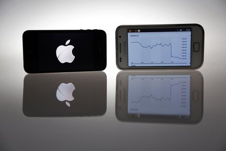An Apple IPhone 4s and Samsung Galaxy S are seen in this illustration photo in Berlin August 27, 2012. REUTERS/Pawel Kopczynski