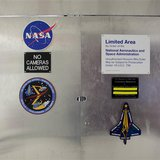 Locked doors, behind which is a room housing pieces of Space Shuttle Columbia, are pictured at the Kennedy Space Center in Florida, January