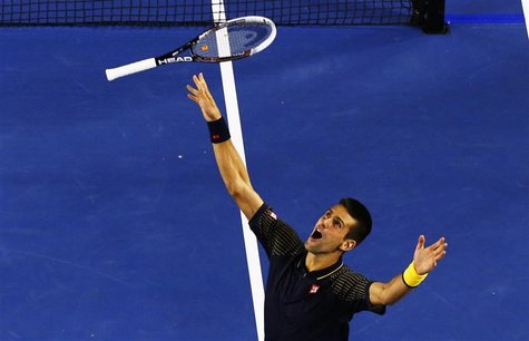 Novak Djokovic of Serbia celebrates defeating Andy Murray of Britain in their men's singles final match at the Australian Open tennis tourna