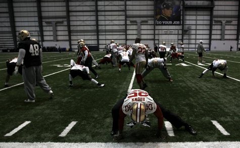 San Francisco 49ers cornerback Tarell Brown (25) stretches with the rest of his team before practice for the Super Bowl in New Orleans, Janu