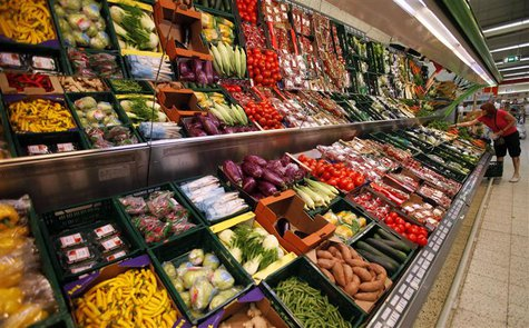 A customer selects vegetables at a supermarket in Prague June 14, 2011. REUTERS/David W Cerny