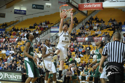 Shayne Whittington dunks at University Arena. Photo courtesy of wmubroncos.com