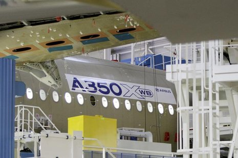 The main body section of the first Airbus A350 is seen on the final assembly line in Toulouse, southwestern France, October 23, 2012. REUTER