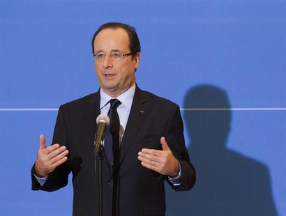 French President Francois Hollande speaks to journalists in Grenoble about the liberation of Florence Cassez January 23, 2013. REUTERS/Rober