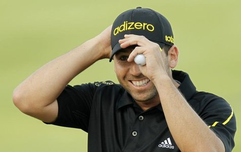 Spain's Sergio Garcia reacts during the final round of the Commercial Bank Qatar Masters at the Doha Golf Club January 26, 2013. REUTERS/Moh