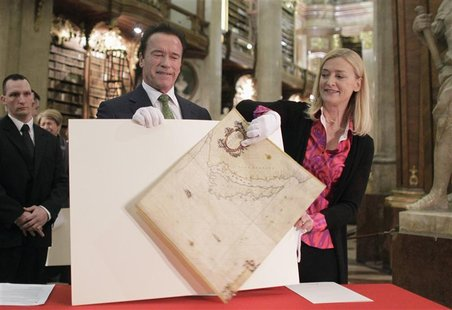 Former U.S. governor of California Arnold Schwarzenegger (L) looks on as director of the Austrian National Library (Oesterreichische Nationa