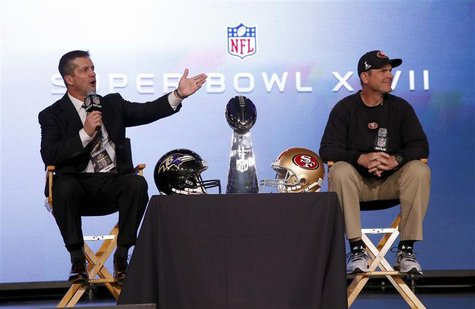 San Francisco 49ers head coach Jim Harbaugh (R) and his brother, Baltimore Ravens head coach John Harbaugh, appear at their joint press conf