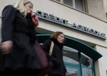 Passers-by walk in front of a branch of French bank Credit Agricole in Marseille February 1, 2013. REUTERS/Jean-Paul Pelissier