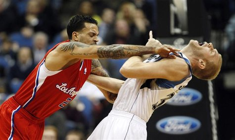 L.A. Clippers' forward Matt Barnes (L) pushes Minnesota Timberwolves' center Greg Stiemsma during the first half of their NBA basketball gam