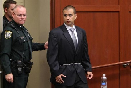 George Zimmerman (R) arrives at the courthouse for his appearance before Circuit Judge Kenneth Lester Jr. at the Seminole County Courthouse