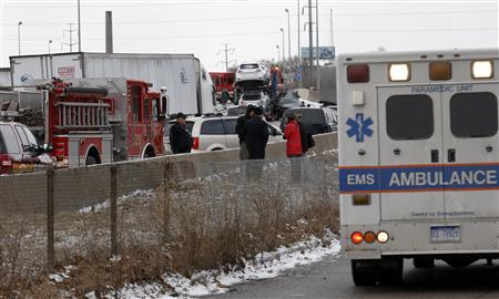 First responders and police officers shut down a freeway due to an accident involving multiple cars and semi-trucks in Detroit, Michigan January 31, 2013. Three people were killed and roughly two dozen were injured. Credit: REUTERS/Rebecca Cook