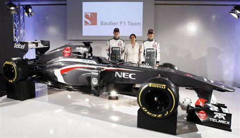 Sauber Formula One team principal Monisha Kaltenborn (C) poses with F1 drivers Nico Hulkenberg (L) of Germany and Esteban Gutierrez of Mexic