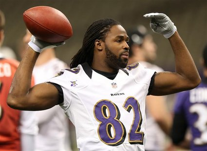 Baltimore Ravens Torrey Smith throws a ball during a practice at the Superdome ahead of the NFL's Super Bowl XLVII in New Orleans, Louisiana