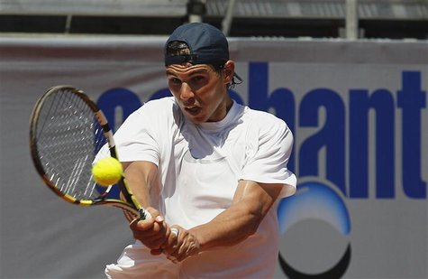 Spanish tennis player Rafael Nadal hits a return during a training session at country club Las Salinas in Vina del Mar city, about 121 km (7