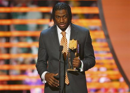 Washington Redskins quarterback Robert Griffin III accepts the the award for the NFL Offensive Rookie of the year during the NFL Honors awar