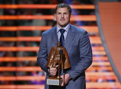 Dallas Cowboys Jason Witten holds the Walter Payton Man of the Year Award after it was presented to him during the NFL Honors award show in