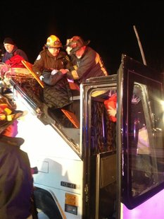 First responders assist injured passensers from a charter bus that crashed in Boston, Massachusettes February 2, 2013. The bus was carrying